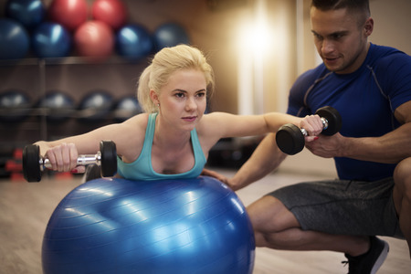 fitness ball: Exercise with fitness ball and weights Stock Photo