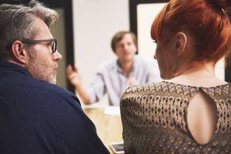 teamwork people: Consulting business things with coworker Stock Photo