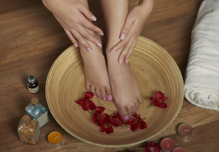 lower section view: Relaxing foot treatment at Spa Stock Photo