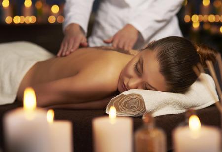 Professional woman making spa treatment Standard-Bild