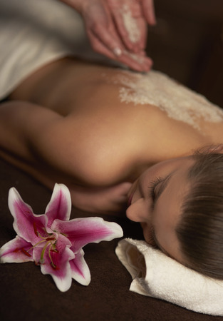 scrubbing up: Exfoliation treatment at the spa Stock Photo