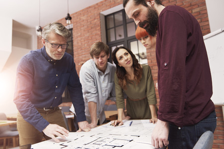 charts graphs: Brainstorming of stylish and creative architects Stock Photo