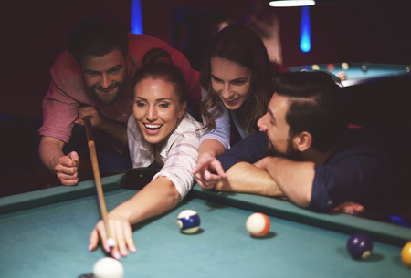 bending over: Friends supporting girl while playing Stock Photo