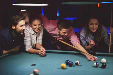 bending over: Group of friends playing pool game