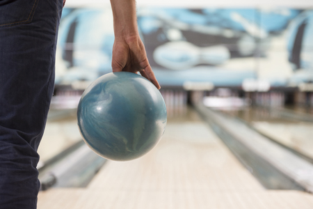 lower section view: Man about to push the bowling ball