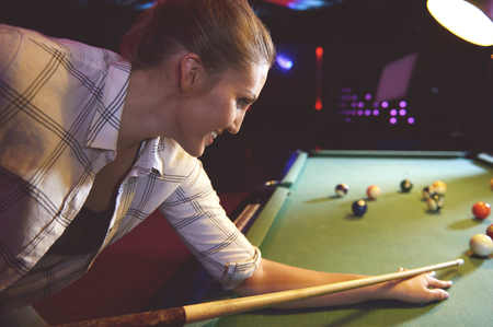 pool game: Woman ready to start the pool game