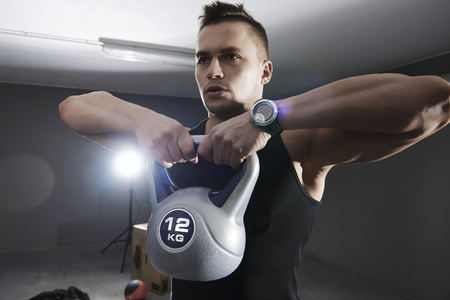 man gym: Shoulder muscle exercise with kettlebell