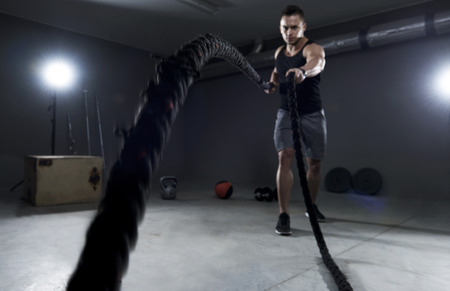 Battle ropes exercise in the garage Stock Photo - 55222859