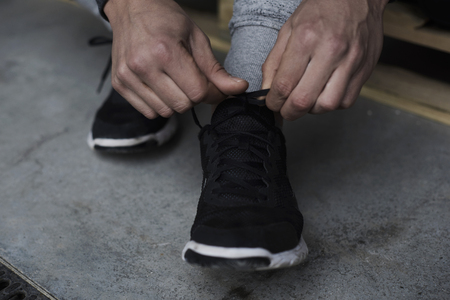 lower section view: Man preparing for the workout