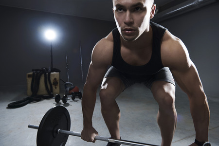 man front view: Front view of man lifting some weights Stock Photo