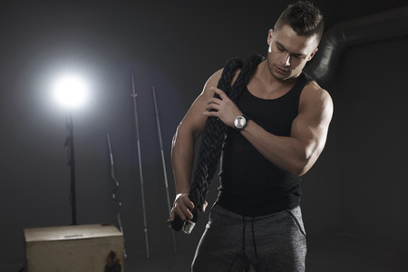 carrying heavy: Strong man carrying heavy gym ropes Stock Photo