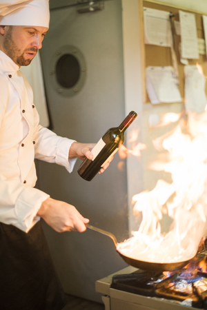 chef kitchen: Flames made of red wine