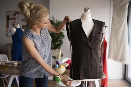 designer working: Begin of high fashion in small workshop Stock Photo