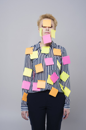 multi tasking: Multi tasking woman with colorful papers
