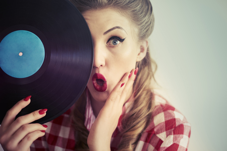 sexy female: Hiding behind an old vinyl Stock Photo