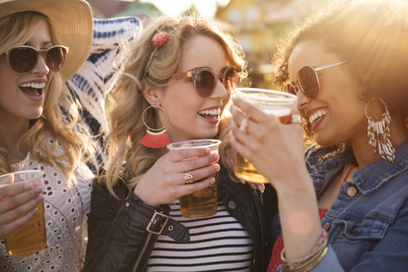 Girls drinking beer at the party