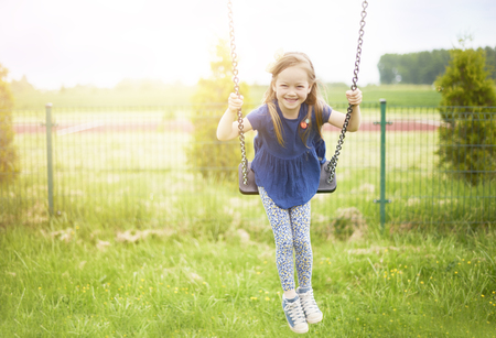 only girls: Favourite place at the playground Stock Photo