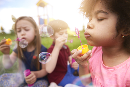 multi age: Blowing the bubbles with my friends