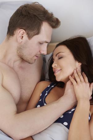 arousal: Man waking up his beloved woman