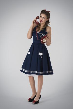retro styled: Retro styled woman with retro telephone