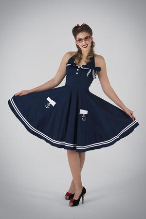 Elegant pin up in marinery dress