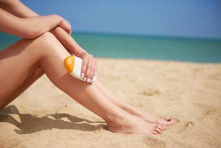 lower limb: Sun cream is essential on holiday Stock Photo