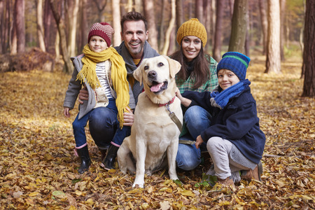 Portrait of happy family during the autumn