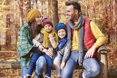 leaning by barrier: Taking family on great trip to forest   Stock Photo
