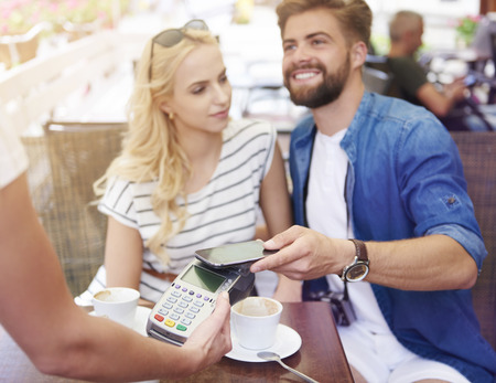 pay for: Comfortable way to pay for bills Stock Photo