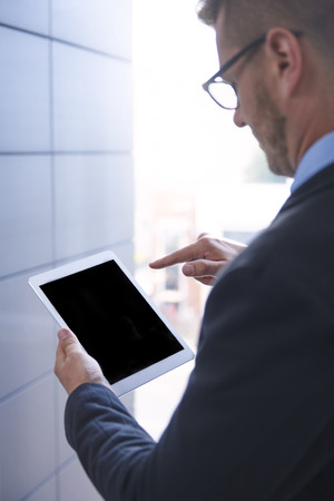 rear view: Rear view of man with digital tablet