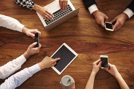 Group of business people using modern technology