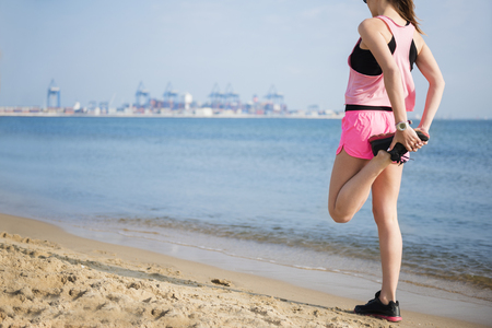 Stretching of legs before jogging