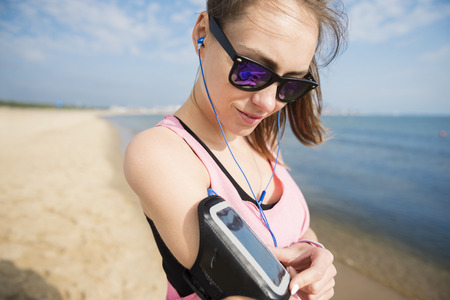 mp3 player: Woman turning her favorite play list