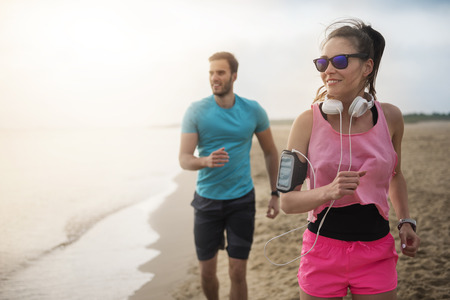 faster: Woman is faster than her boyfriend Stock Photo