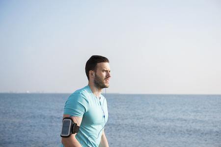 waist up: Waist up image of man after jogging