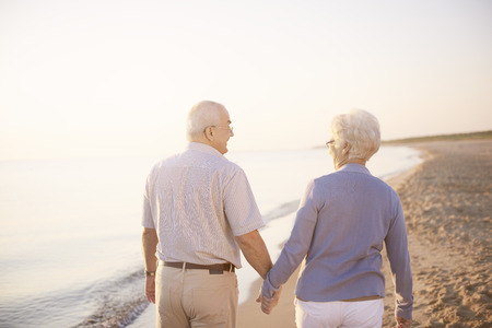holding hands while walking: Holding hands while walking on the beach