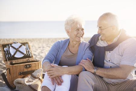 happy seniors: Cheerful senior couple on the picnic Stock Photo