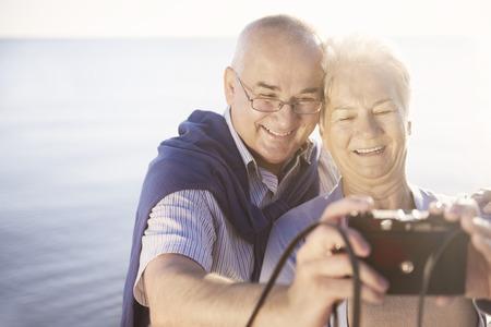 taking a wife: Seniors taking selfie on the beach