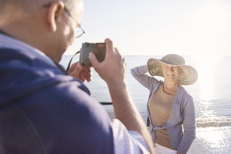 taking a wife: Senior man taking photos of his wife