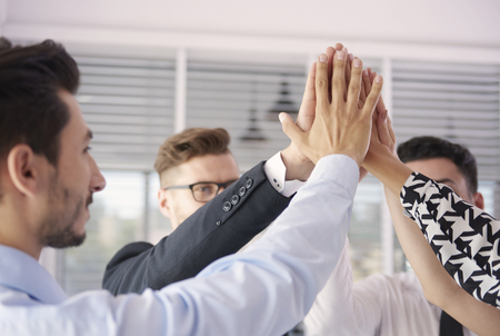 hands high: The symbol of success in the company Stock Photo