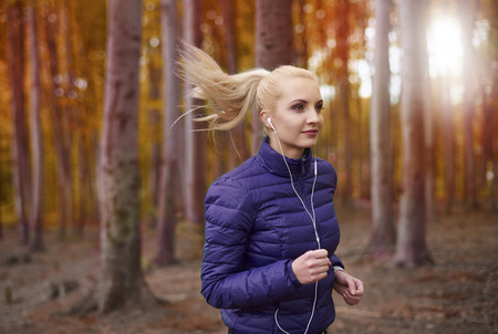 Jogging in autumn in the forest