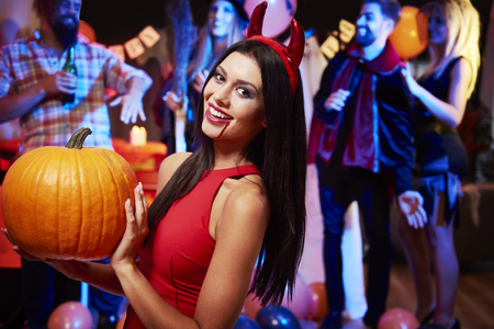 sexy devil: Sexy devil with big pumpkin Stock Photo