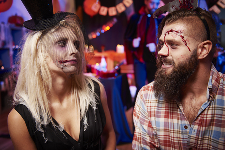 dressing up costume: Creepy man and woman at the party