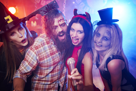 dressing up costume: Creepy friends singing some songs Stock Photo