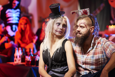 couples hug: Scary couple at halloween party