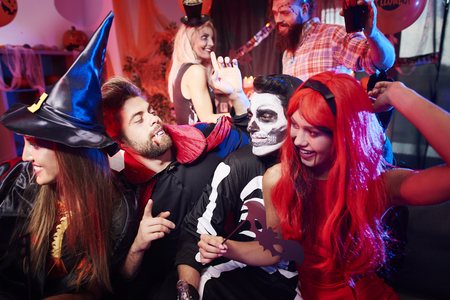dressing up costume: Friends dancing at Halloween party