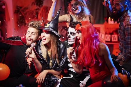 Karoke show at halloween party Stock Photo