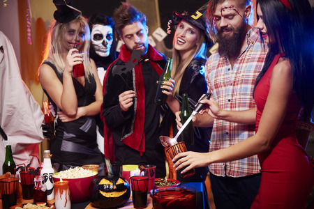 dressing up costume: Drinking punch at halloween party Stock Photo