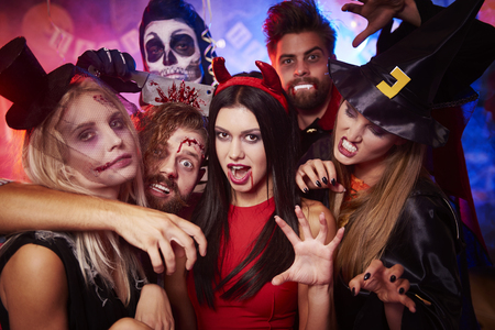 dressing up costume: Group of creepy friends at the party