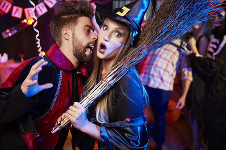 stage costume: Vampire and witch at Halloween party Stock Photo